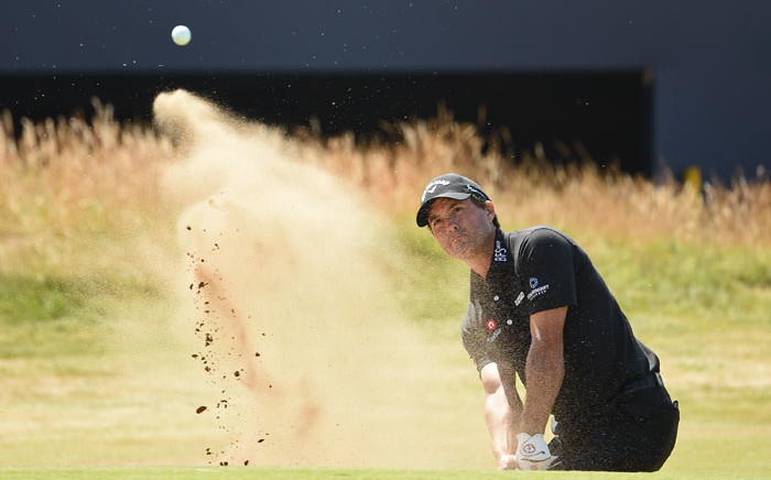 Kevin Kisner plays a shot out of the bunker at the British Open at Carnoustie, Scotland on 19 July 2018. Picture: AFP
