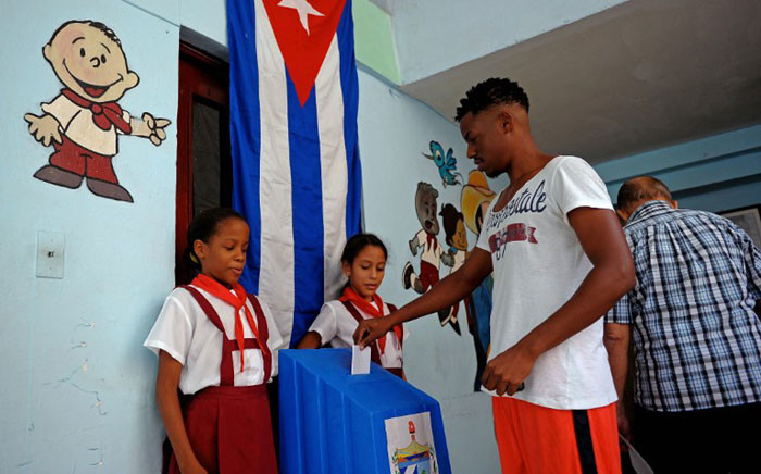 A Cuban casts his vote at a polling station in Havana Vieja neighbourhood in Havana, on November 26, 2017, during municipal elections. Picture: AFP.