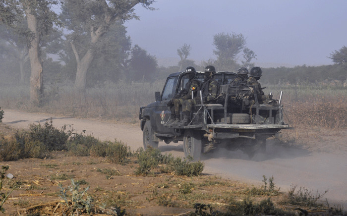 FILE: Members of the Cameroonian Rapid Intervention Force patrol on the outskirt of Mosogo in the far north region of the country where Boko Haram jihadist have been active since 2013, on 21 March 2019. Picture: AFP