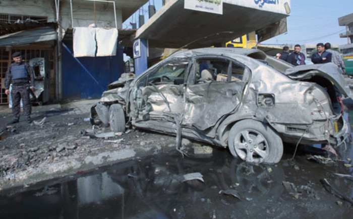The site of a car bomb in central Baghdad, on 15 January, 2014. Picture: AFP.