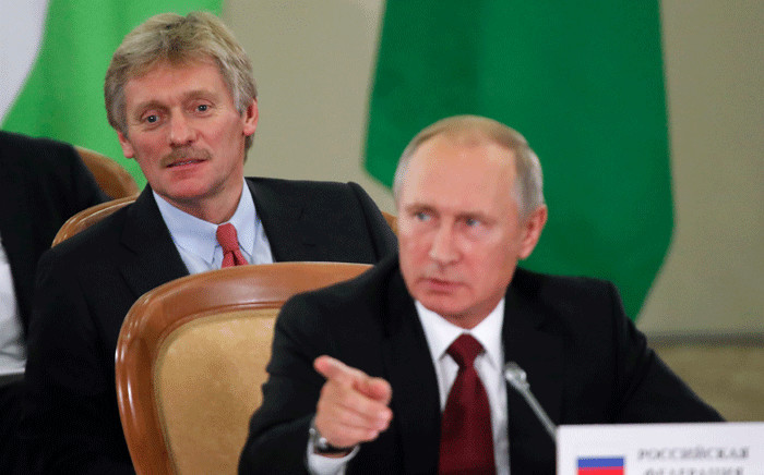 FILE: Russia's President Vladimir Putin (front) and Kremlin spokesperson Dmitry Peskov. Picture: AFP.