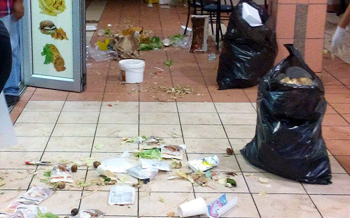 Students were unable to get food from the Neelsie student centre as a group of outsourced workers protested inside and locked down the centre on 11 February 2016. Picture: Nation Nyoka.