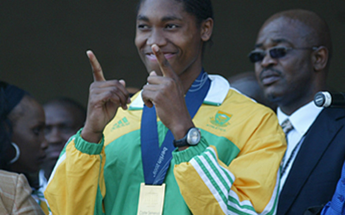 South Africa's golden girl Caster Semenya waves at her fans after arriving at OR Tambo on 25 August, 2009. Picture: Taurai Maduna/Eyewitness News