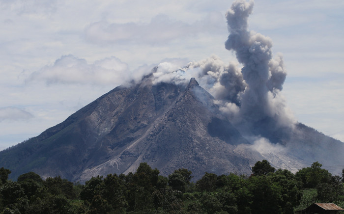 FILE: The Sinabung volcano spews hot clouds of ash, as seen from the Simpang Empat subdistrict in Karo, North Sumatra. Picture: AFP.