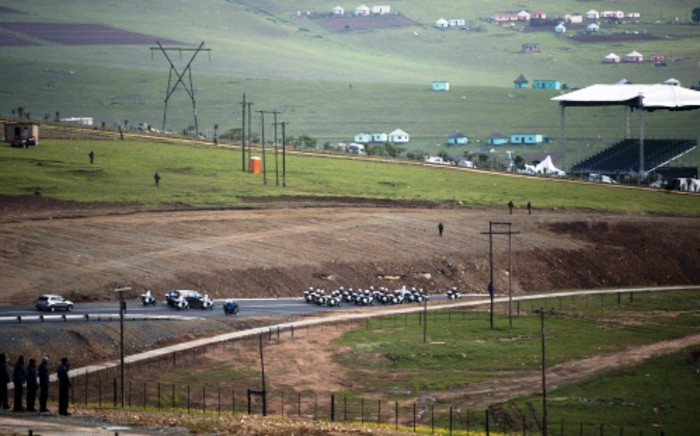 The cortege transporting Nelson Mandela's body arrives in Qunu  ahead of his 15 December funeral on 14 December 2013. Picture: AFP.