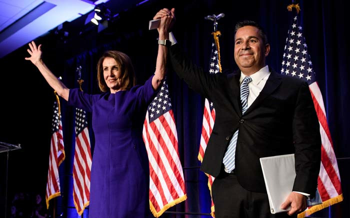 House Minority Leader Nancy Pelosi (D-CA) and Representative Ben Ray Lujan (D-MN), DCCC Chairman, celebrate a projected Democratic Party takeover of the House of Representatives during a midterm election night party hosted by the Democratic Congressional Campaign Committee on 7 November 2018 in Washington, DC. Picture: AFP
