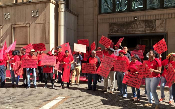 Union members from Cosatu picketing outside the Chamber of Mines calling on mining companies to take the safety of miners more seriously. Picture: Katleho Sekhotho/EWN.