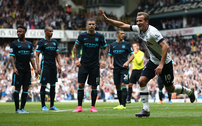 Tottenham Hotspur's English striker Harry Kane celebrates after scoring their third goal during the English Premier League football match between Tottenham Hotspur and Manchester City at White Hart Lane in north London on September 26, 2015. Picture: AFP.