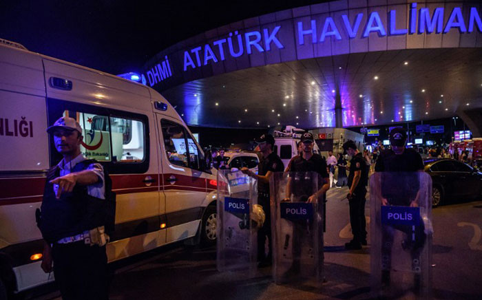 Turkish anti-riot police officers secure the main entrance of the Ataturk airport in Istanbul ON 28 June, 2016 after two explosions followed by gunfire hit Turkey's biggest airport, killing at least 36 people and injuring hundreds. Picture: AFP.