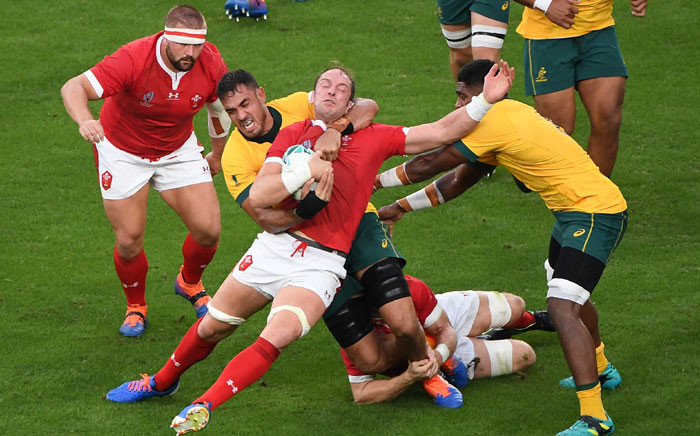 Wales' lock Alun Wyn Jones (C) is is tackled by Australia's lock Rory Arnold (C-L) during the Japan 2019 Rugby World Cup Pool D match between Australia and Wales at the Tokyo Stadium in Tokyo on 29 September 2019. Picture: AFP