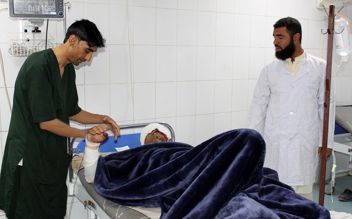A wounded man receives medical treatment at a hospital after a car bomb attack on an Afghan police base in Khost province on October 27, 2020. Picture: AFP