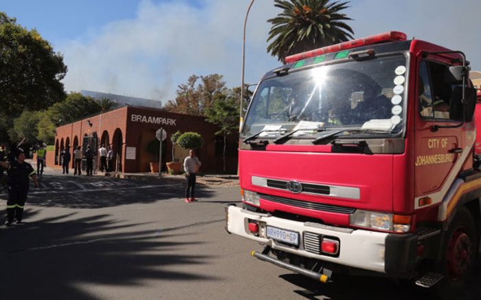 Emergency services at the scene of a burning building at Braampark in Braamfontein. Picture: Christa Eybers/EWN.