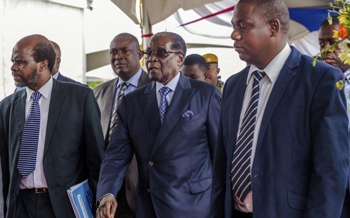 Zimbabwe's President Robert Mugabe (centre) arrives for a graduation ceremony at the Zimbabwe Open University in Harare on 17 November 2017. This is his first public appearance since a military takeover on 14 November 2017. Picture: AFP
