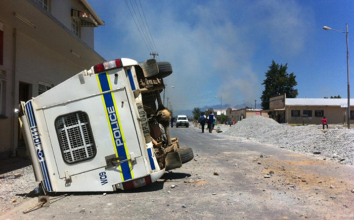A police vehicle overturned during violent farm protests in Wolseley on 14 November 2012. Picture: Graeme Raubenheimer/EWN