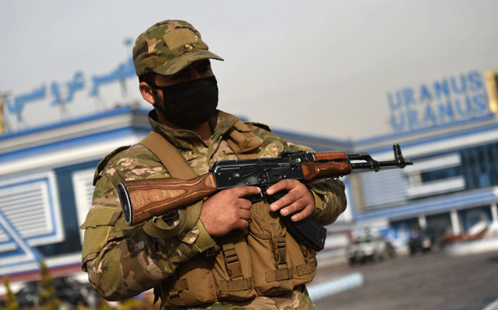 FILE: A member of the Afghan security forces stands guard outside of a wedding hall a day after a deadly suicide attack in Kabul on 21 November 2018. Picture: AFP