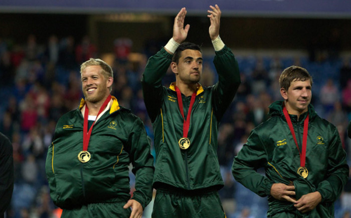 FILE: Springbok Sevens players celebrate with the fans after claiming gold against New Zealand at the Commonwealth Games on 27 July 2014. Picture: Facebook.