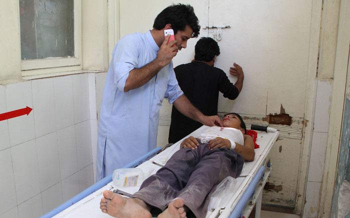 An Afghan wounded boy receives treatment at a hospital following multiple explosions in Jalalabad on 11 September 2018. Picture: AFP