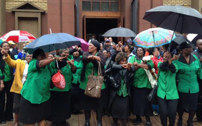 ANC Women's League member sing outside the Pretoria High Court ahead of the first day of the Oscar Pistorius murder trial on 3 March 2014. Picture: Govan Whittles/EWN.