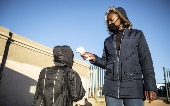 FILE: Children getting their temperature checked at Goza primary school in Soweto. Picture: Abigail Javier/EWN