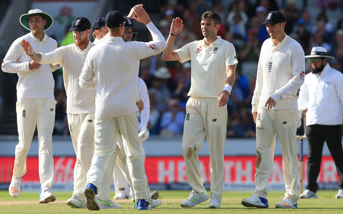 England's James Anderson celebrates with teammates the wicket of South Africa's Theunis de Bruyn for 11 on the second day of the fourth Test match between England and South Africa at Old Trafford cricket ground in Manchester on 5 August, 2017. Picture: AFP