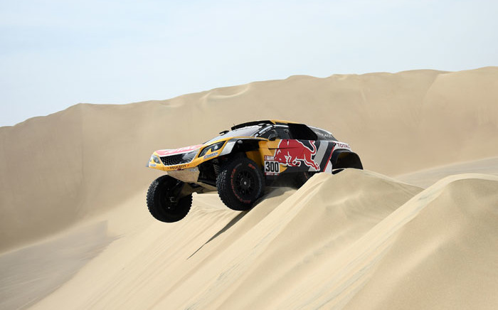 Peugeot driver Stephane Peterhansel drops down a sand dune in the Dakar Rally on 8 January, 2018. Picture: AFP