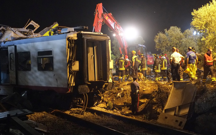 Rescuers work after a head-on collision between two trains, near Corato, in the southern Italian region of Puglia on 12 July, 2016. Picture: AFP.