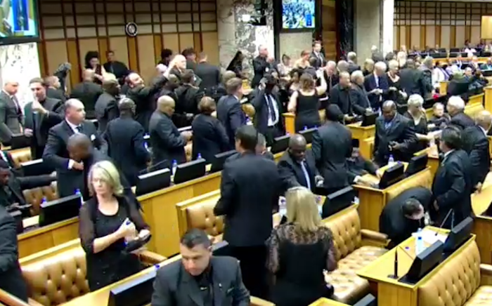 Democratic Alliance MPs walk out of Parliament during the 2015 State of the Nation Address on 12 February.