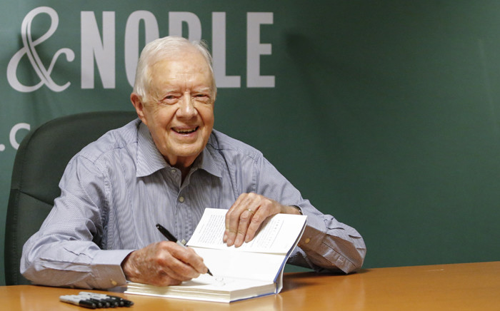 File picture taken 7 July, 2015 shows former US President Jimmy Carter signing his new Book A Full Life: Reflections at Ninety at Barnes & Noble on 5th avenue in New York. Picture: AFP.