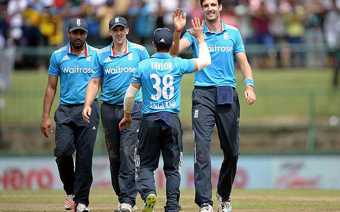 England bowler Steven Finn (R) is congratulated by his teammates after a taking a wicket during a tri-series match in Australia, December 2014. Picture: Official ECB Facebook.