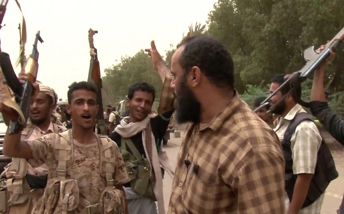 This image grab taken from a video shows Yemeni pro-government forces gathering at the south of Hodeida airport, in Yemen's Hodeida province on 15 June 2018. Picture: AFP.