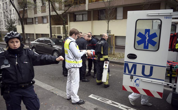 Twelve people have been confirmed dead, including two police officers in Paris shooting. Picture: AFP.