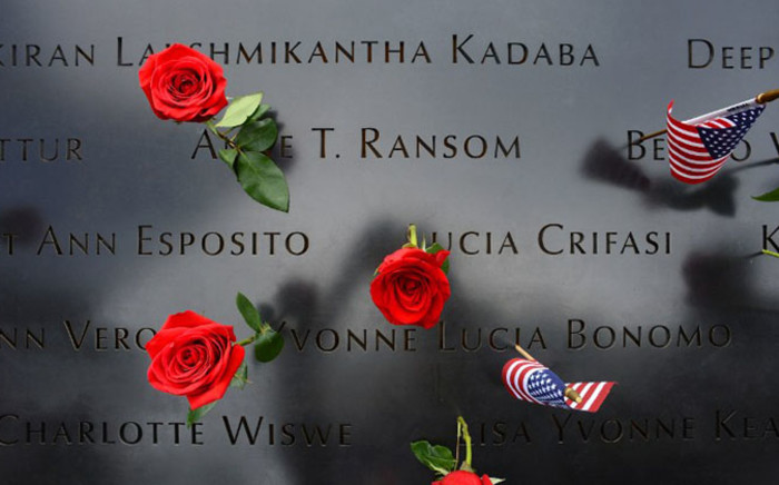 FILE: Roses and flags left by loved ones at the North Pool during memorial observances held at the site of the World Trade Center in New York, 11 September 2014. Picture: AFP.
