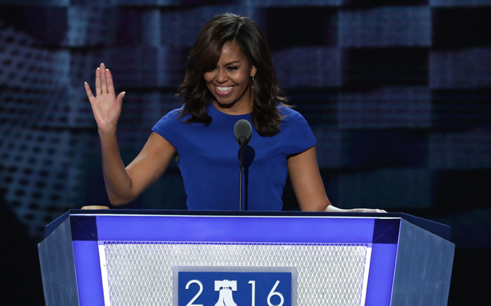 First lady Michelle Obama acknowledges the crowd after delivering remarks on the first day of the Democratic National Convention at the Wells Fargo Center, 25 July, 2016 in Philadelphia, Pennsylvania. Picture: AFP.