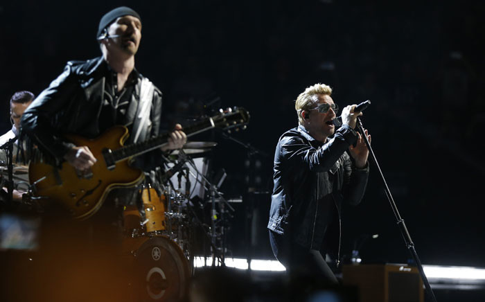 Irish band U2 singer Bono (R) and guitarist The Edge (L)perform on stage at the Bercy Accordhotels Arena in Paris on December 6, 2015. Picture: AFP.