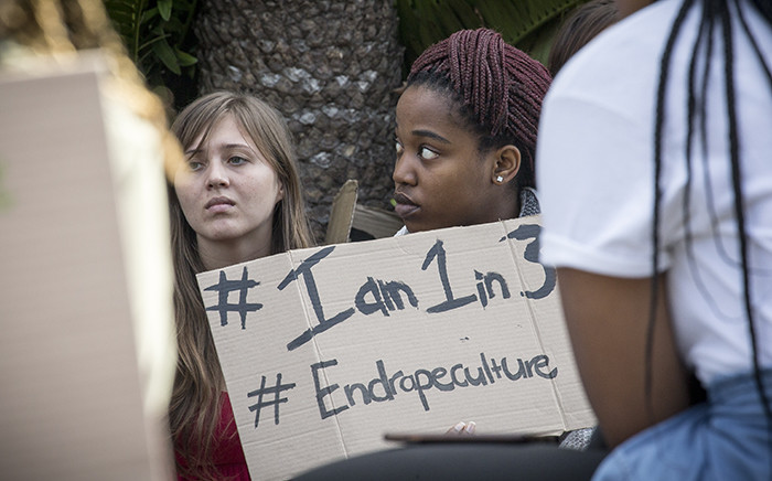 A UCT student holds up a poster during a protest against rape and sexual abuse on campus on 11 May 2016. Picture: Thomas Holder/EWN