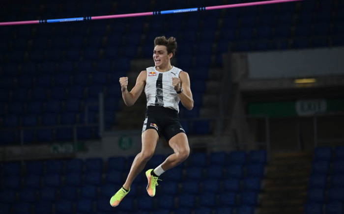 Sweden's Armand Duplantis celebrates as he wins in the men's pole vault during the IAAF Diamond League competition on 17 September 2020 at the Olympic Stadium in Rome. Picture: AFP