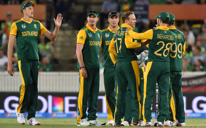 FILE: South Africa's players celebrate a wicket during the 2015 Cricket World Cup Pool B match between Ireland and South Africa in Canberra on 3 March, 2015. Picture: AFP