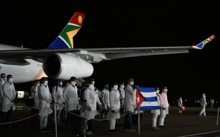 More than 200 Cuban doctors arrived in the country early on Sunday morning to bolster support in the fight against Covid-19. Picture: GCIS.