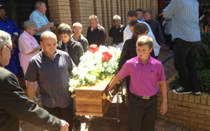 Corrie Sanders' casket is carried out of the NG Kerk in Wonderpark, Pretoria North, after his funeral by his brother Mike (front left) and son Dean (front right). Picture: Barry Bateman/EWN.