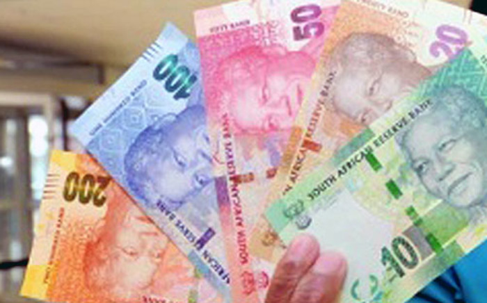 South Africa's rand begins the week sliding more than two percent against the dollar.