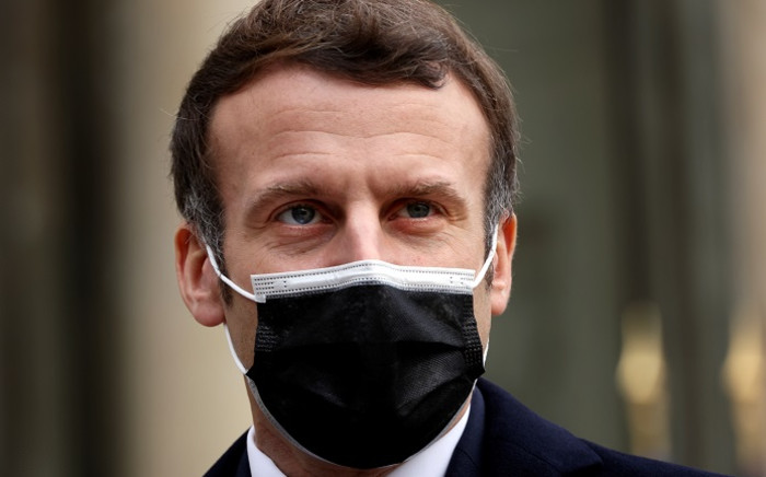 A picture taken on 16 December 2020 shows French President Emmanuel Macron addressing the press upon the arrival of Portuguese Prime minister for a working lunch at the Elysee presidential palace in Paris. Picture: AFP.