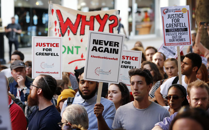 Demonstrators gather with placards outside the Department for Communities and Local Government in central London on 16 June 2017 to demand justice for those affected by the Grenfell Tower fire. Dozens of people are feared dead in the London tower block fire as emergency workers continued searching for bodies in the high-rise on Friday, warning they may never be able to identify some of the victims. Picture: AFP.