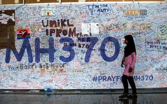 FILE: A girl walks in front of the wall of hope for missing Malaysia Airline flight MH370 at Kuala Lumpur International Airport (KLIA) in Sepang, outside Kuala Lumpur, Malaysia, 12 June 2014. Picture: EPA.