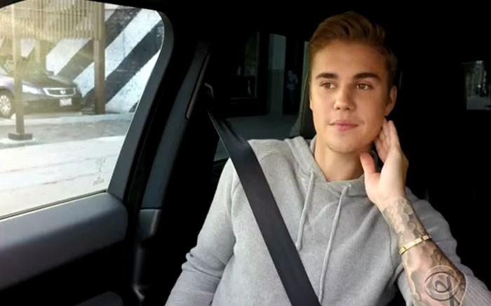 YouTube screengrab of Justin Bieber about to sing karaoke of his own songs in a car.
