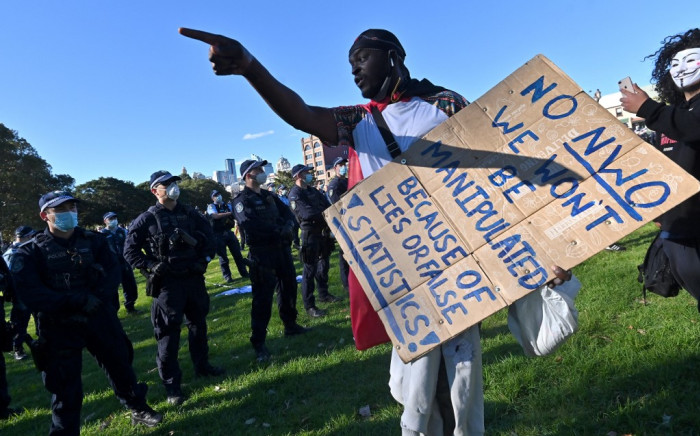 Police block the way to the marching protesters during an anti-lockdown rally in Sydney on 24 July 2021, as thousands of people gathered to demonstrate against the city's month-long stay-at-home orders. Picture: Steven SAPHORE / AFP