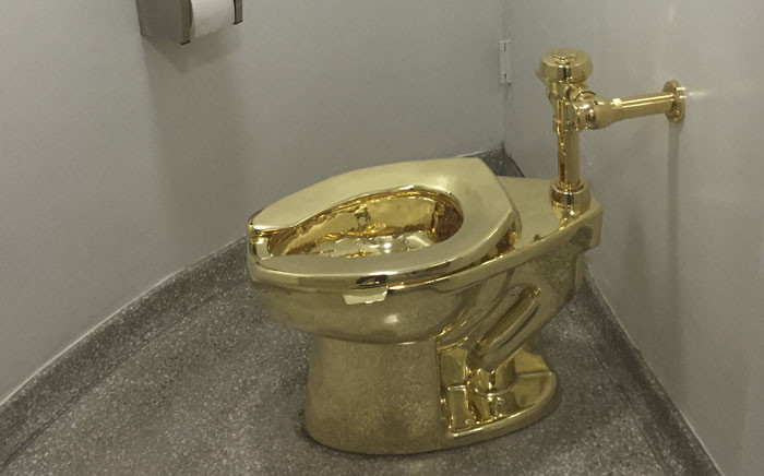 In this file photo taken on 15 September 2016, a fully functioning solid gold toilet, made by Italian artist Maurizio Cattelan, is going into public use at the Guggenheim Museum in New York. Picture: AFP