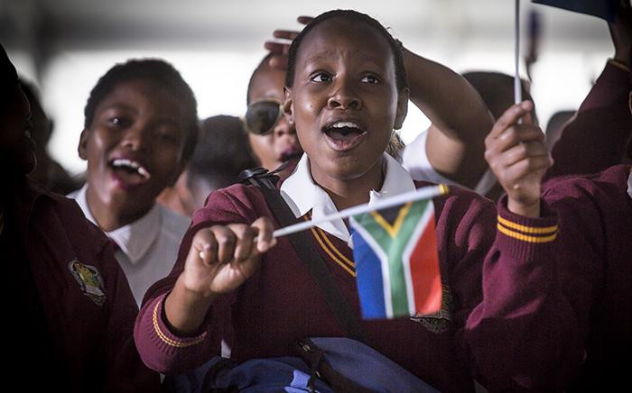 FILE: A young school girl waves a little South African flag ahead of President Jacob Zuma's Youth Day address in Ventersdorp on 16 June 2017. Picture: EWN
