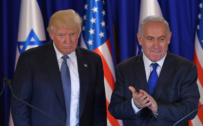 FILE: US President Donald Trump and Israel's Prime Minister Benjamin Netanyahu deliver press statements before an official dinner in Jerusalem on 22 May 2017. Picture: AFP.