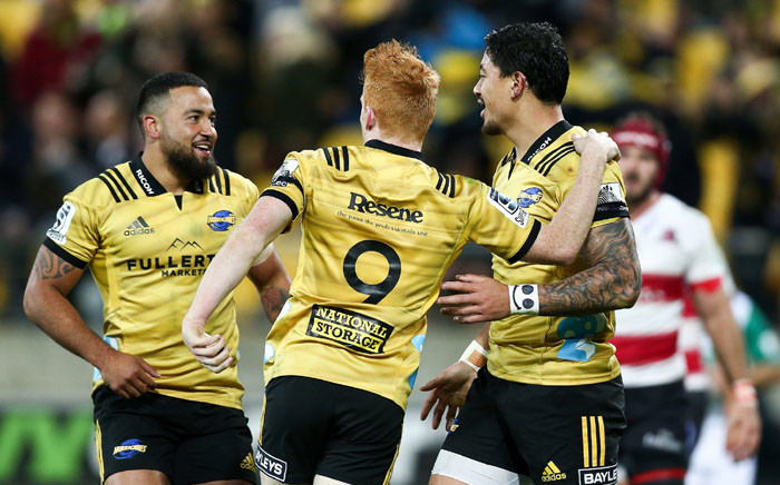 Wellington Hurricanes players celebrate their victory against Lions. Picture: @Hurricanesrugby/Twitter.