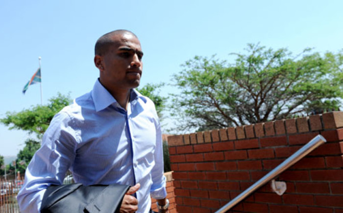 Utility soccer player Bryce Moon, accused of killing domestic worker Mavis Ncube in a car accident, is seen outside the Randburg Magistrate's Court on Monday, 8 October 2012. Picture: Werner Beukes/SAPA